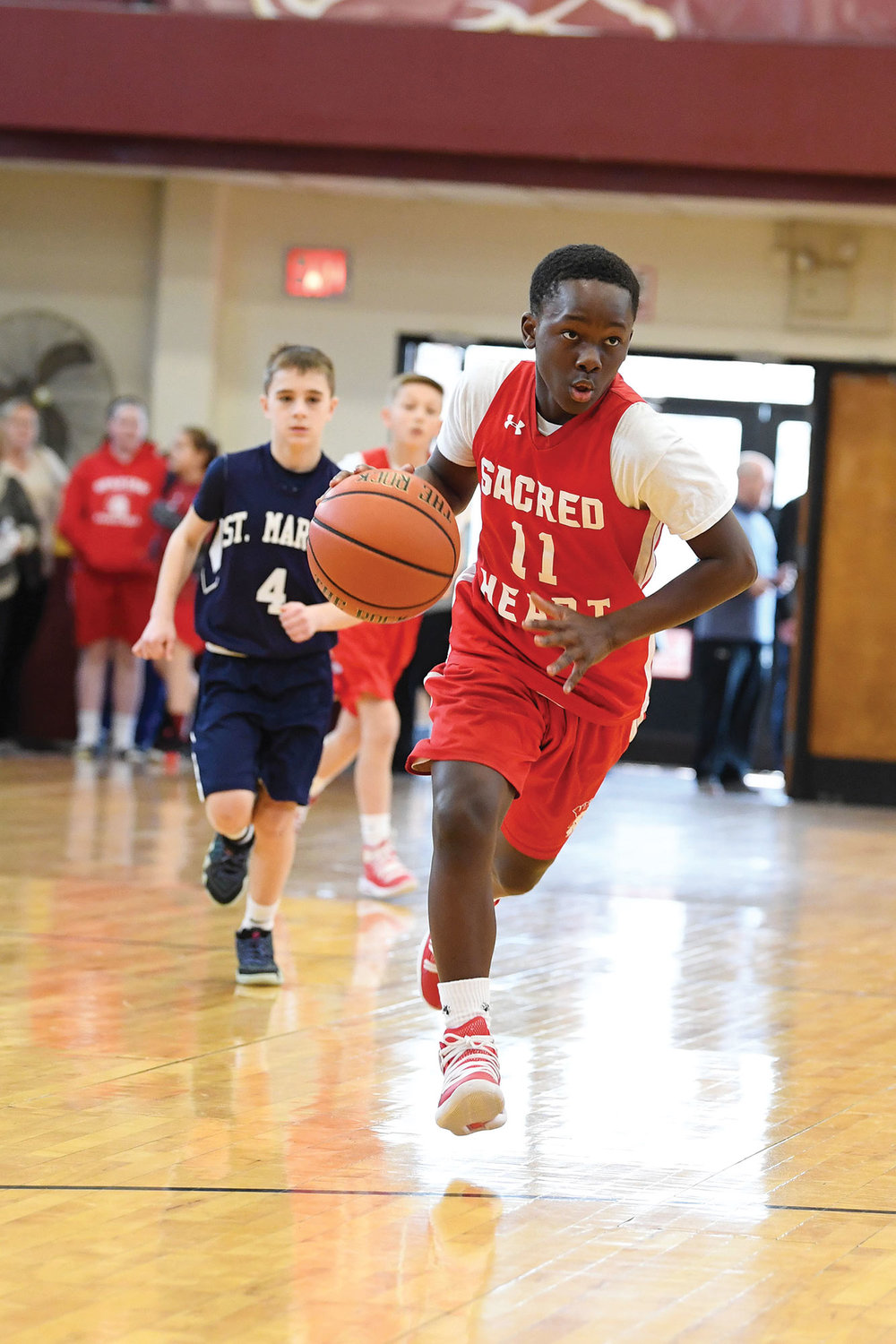 Isaiah Jones of Sacred Heart, Staten Island, brings up the ball against St. Mary, Mother of the Church, Fishkill, in the sixth grade boys' title game.