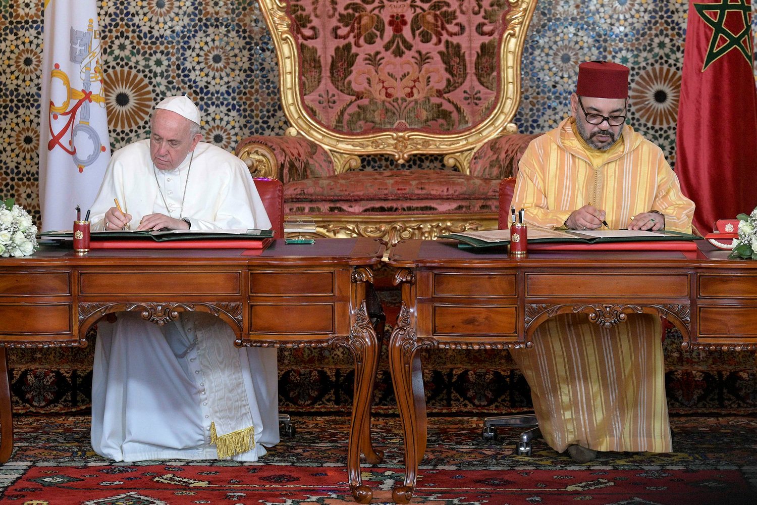 "Pope Francis and King Mohammed VI sign a joint declaration at the royal palace in Rabat, Morocco, March 30. The agreement pleaded for international recognition of ""the unique and sacred character of Jerusalem."""