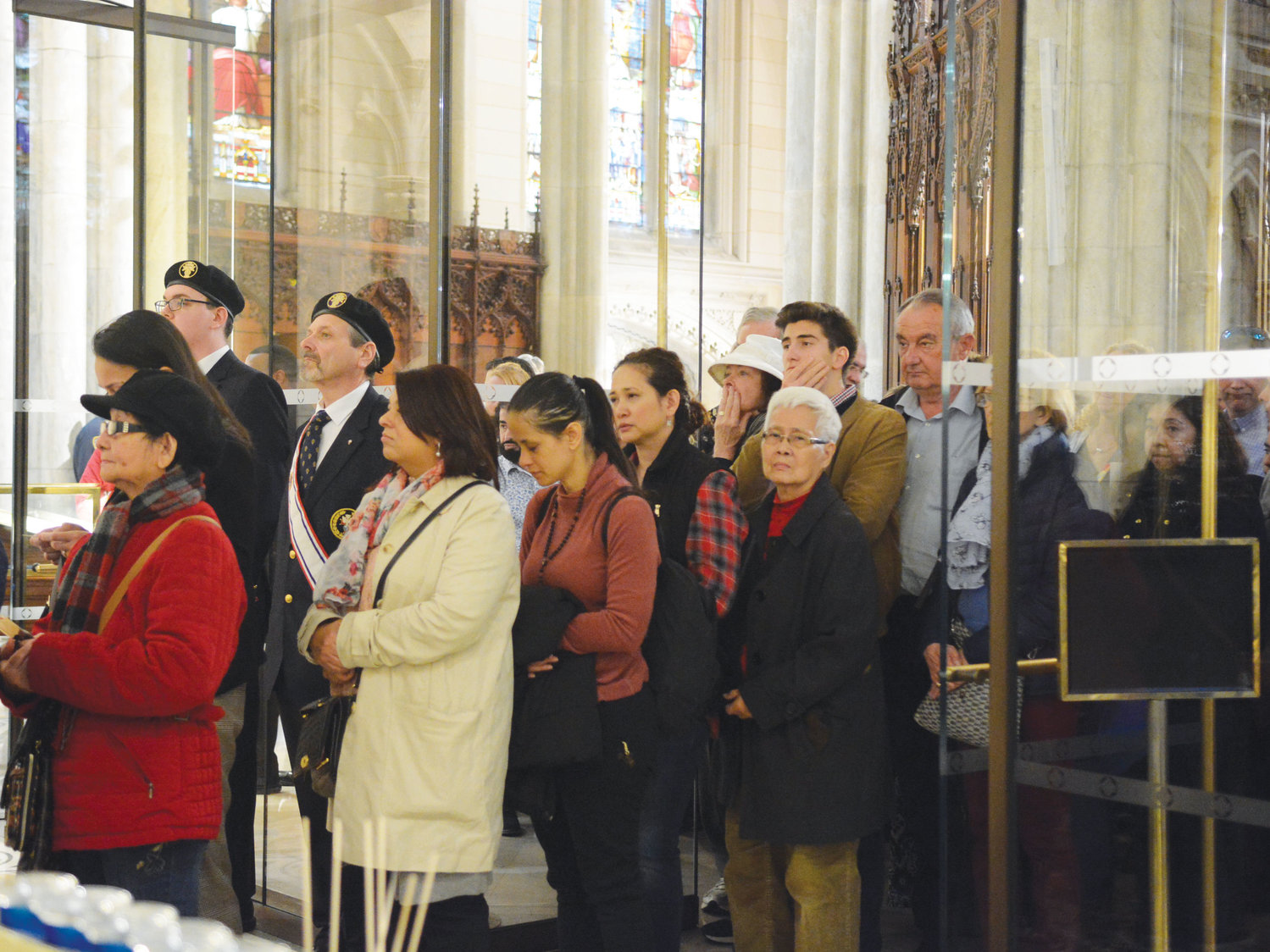 The faithful patiently wait their turn to visit and venerate the first-class relic of St. John Vianney inside the Lady Chapel of St. Patrick's Cathedral on April 7.