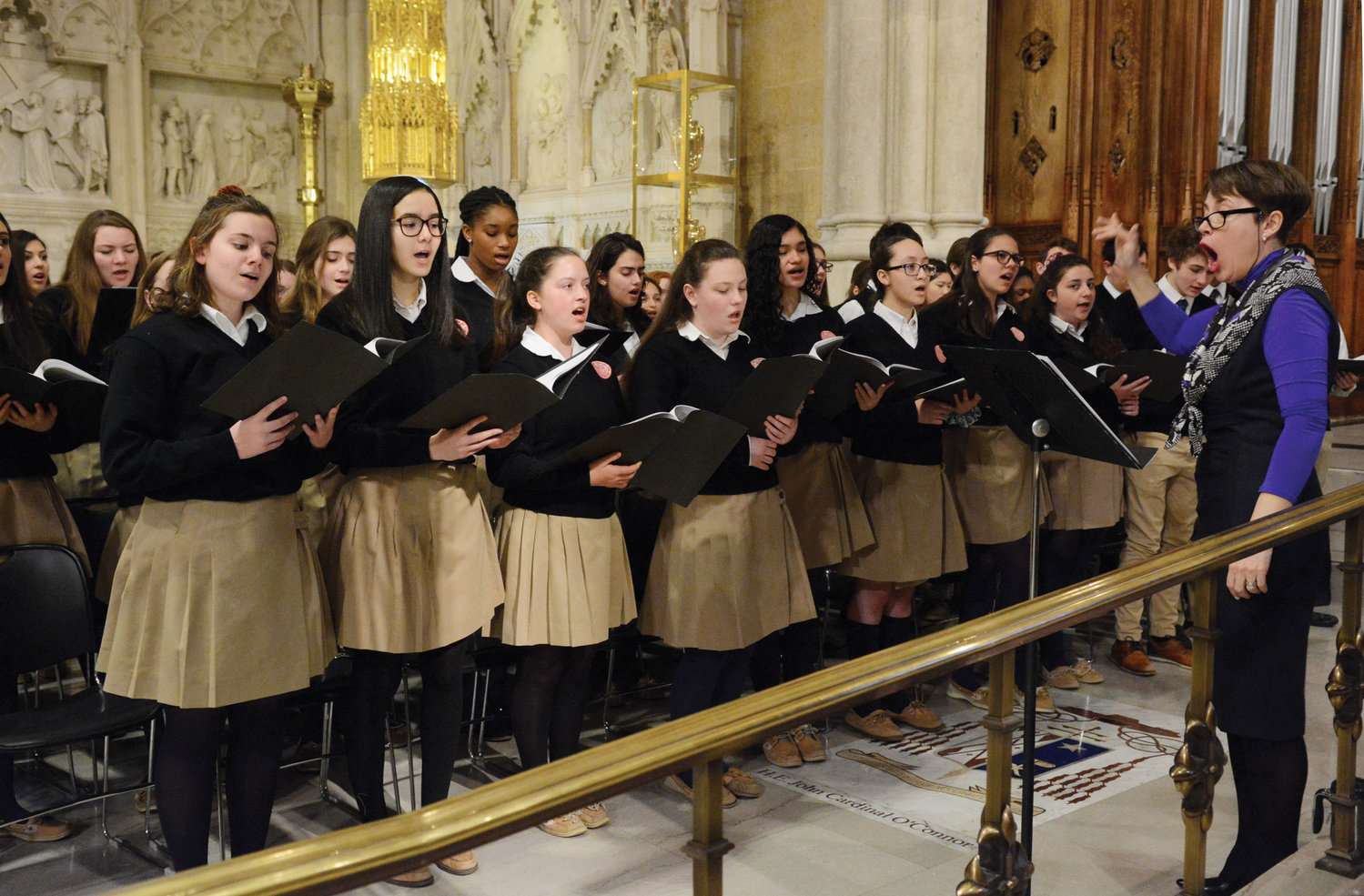 The choir of John F. Kennedy Catholic High School in Somers, under the direction of Ines Wilhelm-Boston, raises their voices in song April 4 at the Mass for the Class of 2019 at St. Patrick's Cathedral.
