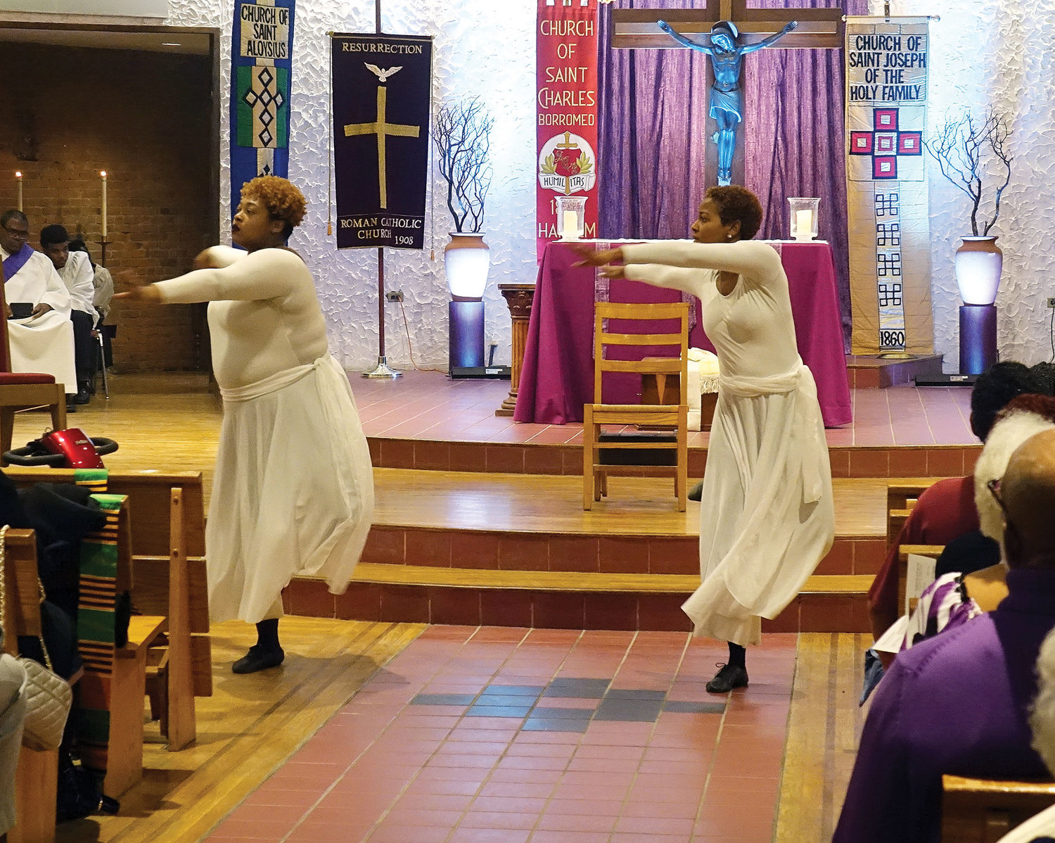 Members of the St. Charles Borromeo Liturgical Dance Ministry display their praise before a packed church.