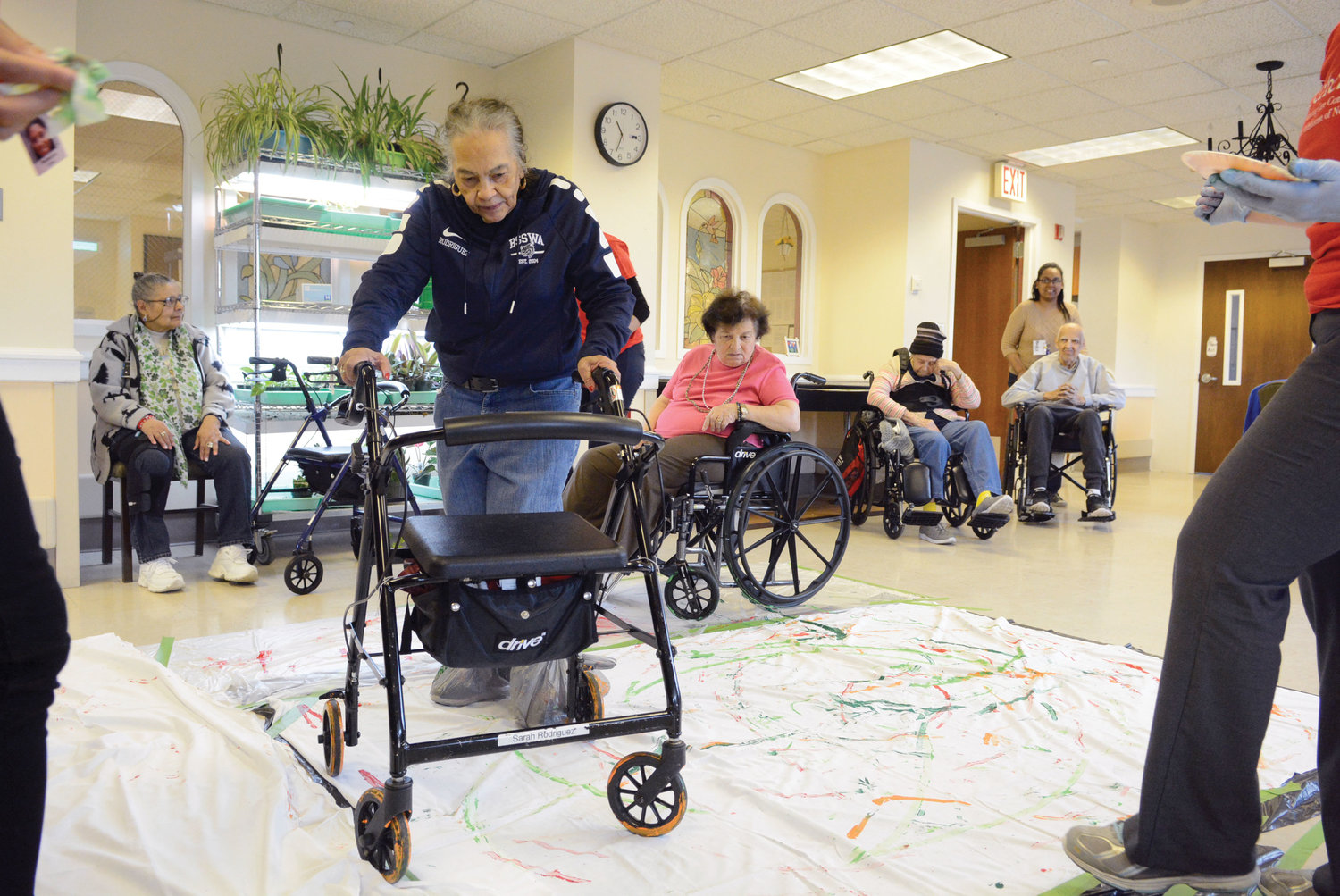 Bronx senior citizens turn their canes, wheelchairs and walkers into paintbrushes as part of a recreation therapy program at ArchCare Senior Life at San Vicente de Paul, the Bronx.