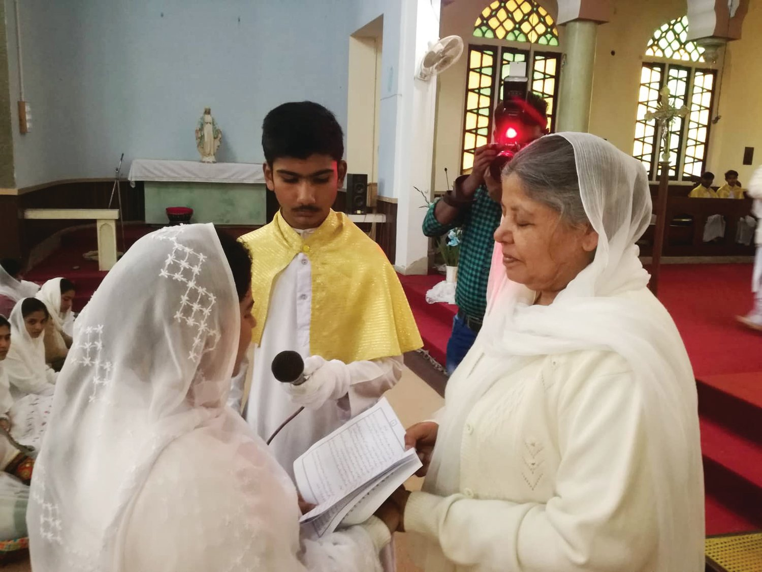Sister Sumaira Patrick, O.P., left, professes her final vows in St. Dominic's Church in Bahawalpur, Pakistan, March 2. She is one of 22 Dominican Sisters of Sparkill serving in Pakistan. Sister Anna Bakshi, O.P., received the vows.