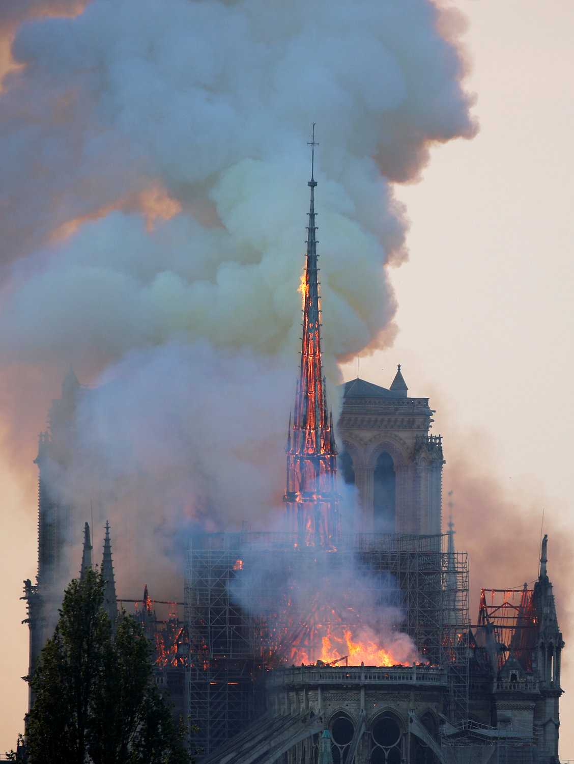 Flames and smoke billow from the Notre Dame Cathedral after a fire broke out in Paris April 15.