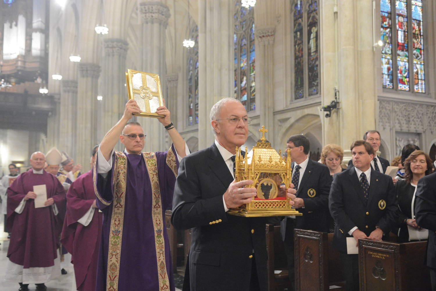 Supreme Knight Carl Anderson processes with the reliquary containing the incorrupt heart of St. John Vianney at the April 7 Mass Cardinal Dolan offered at St. Patrick's Cathedral. Msgr. Robert Ritchie, rector of the cathedral, is pictured third from back, followed by Archbishop William Lori, supreme chaplain of the Knights of Columbus, and Cardinal Dolan.