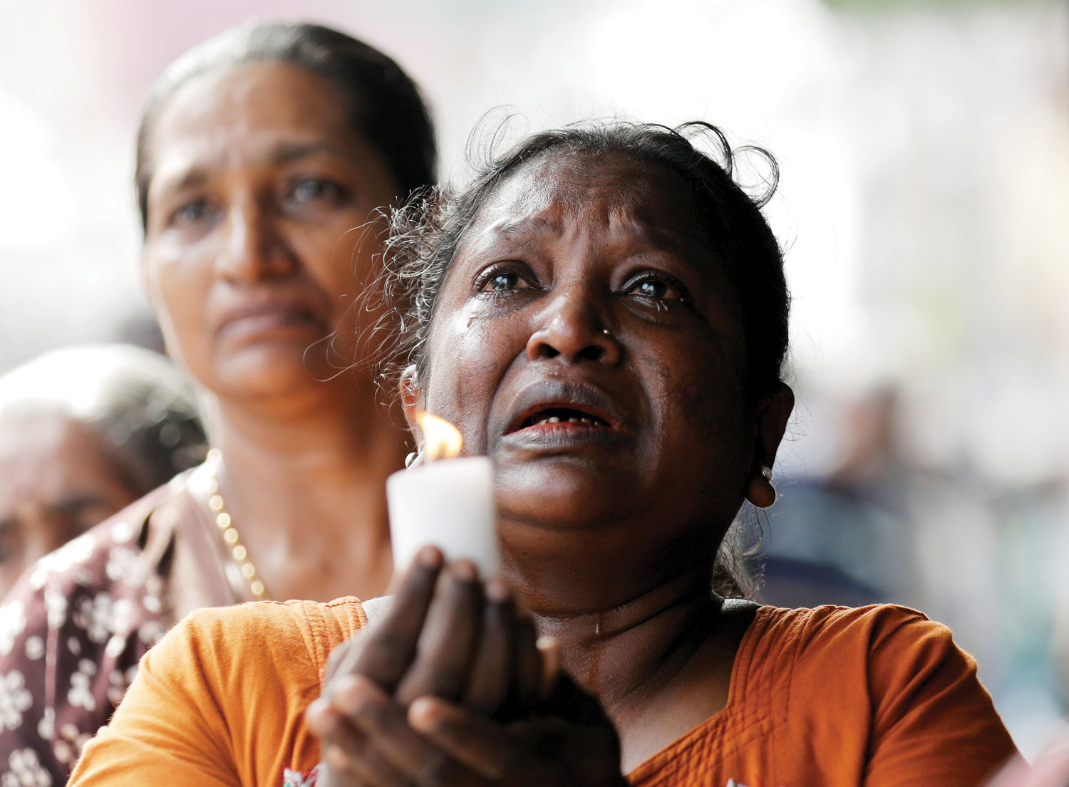 A woman weeps during a memorial service for victims in Colombo, Sri Lanka, April 23, two days after a string of deadly bomb attacks on churches and luxury hotels across the island.