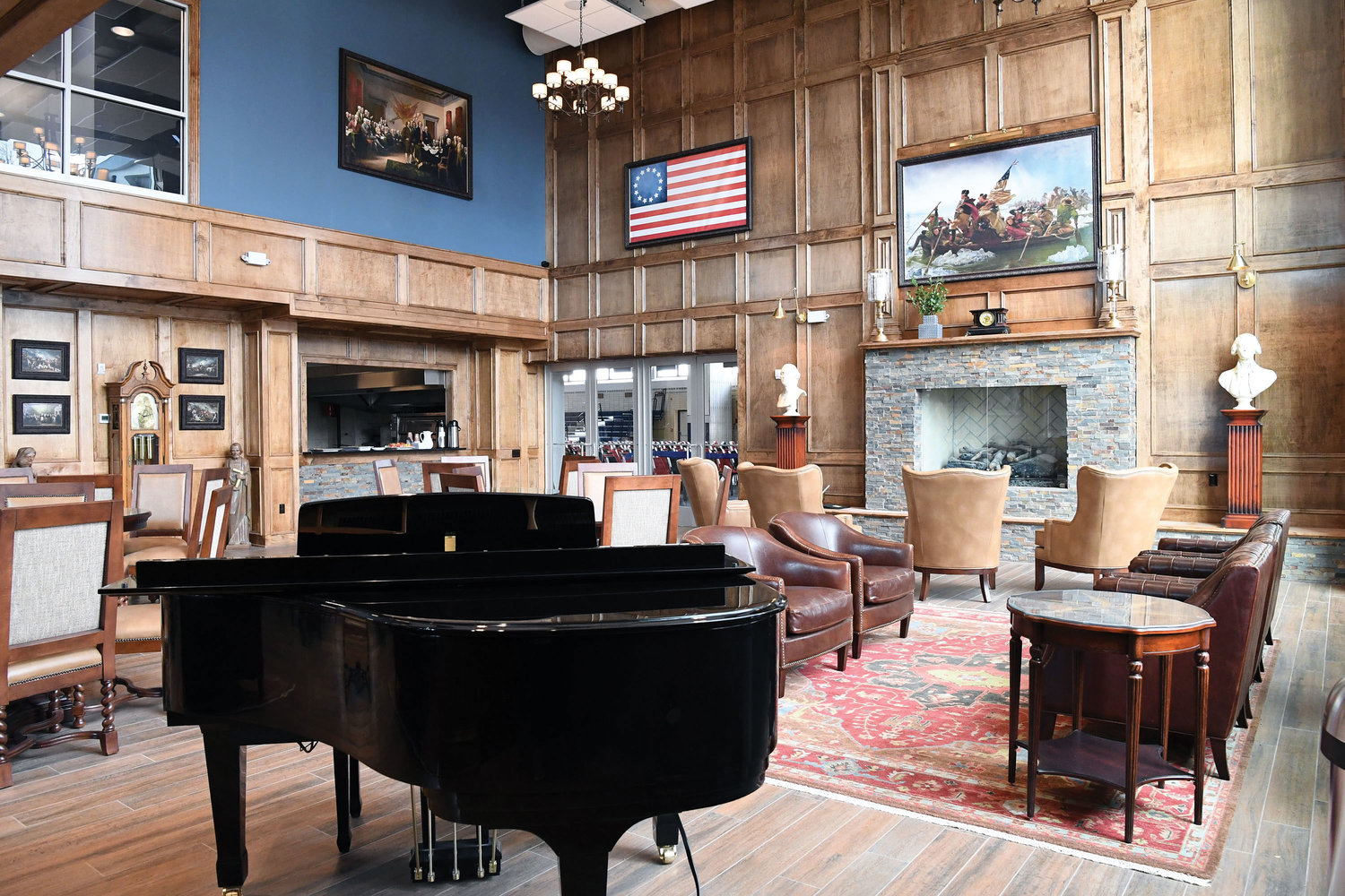 A fireplace, piano, and paintings and décor of historical themes are part of the student center lounge.