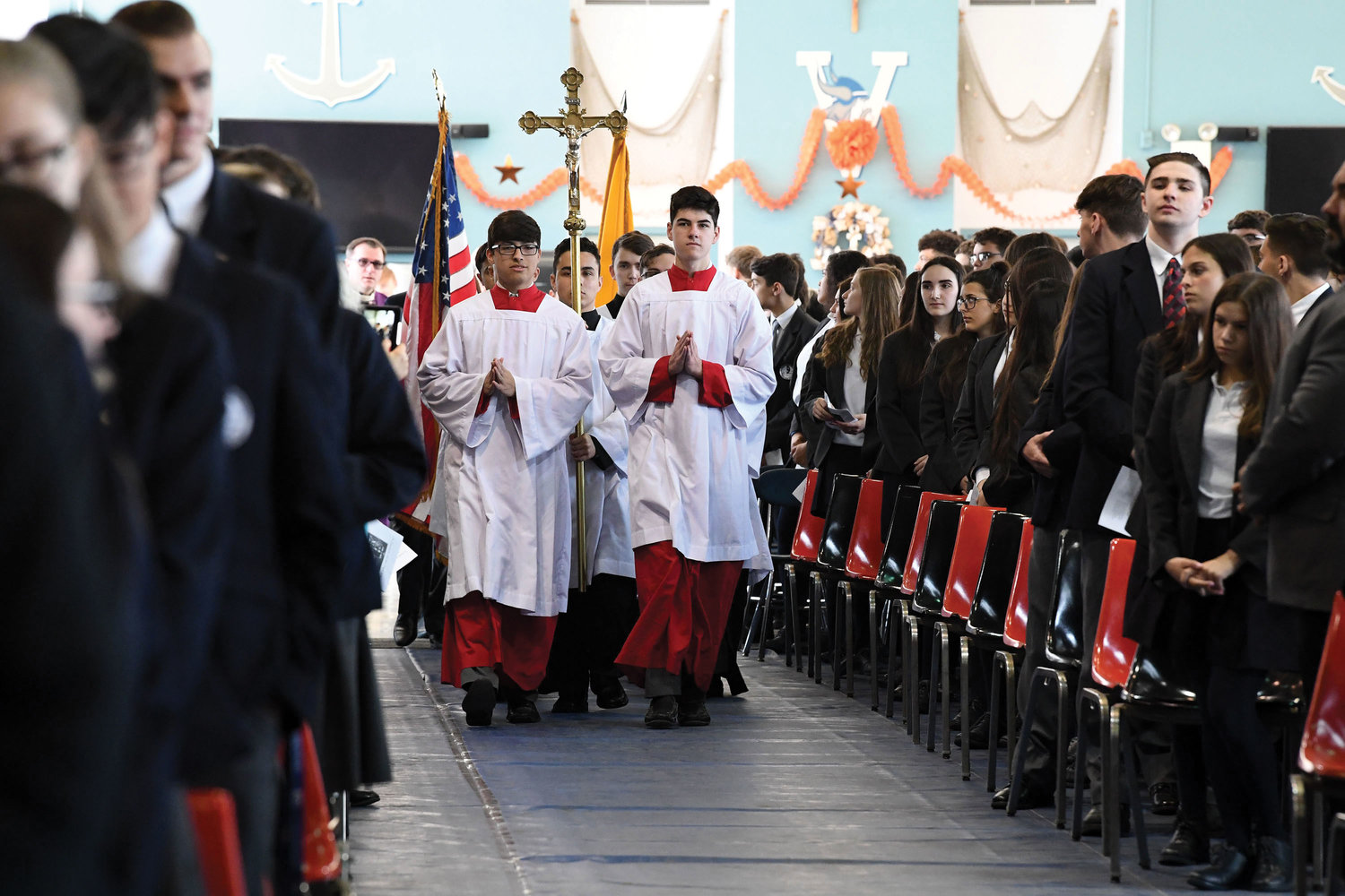 Altar servers lead the procession at the start of Mass celebrated by Cardinal Dolan.