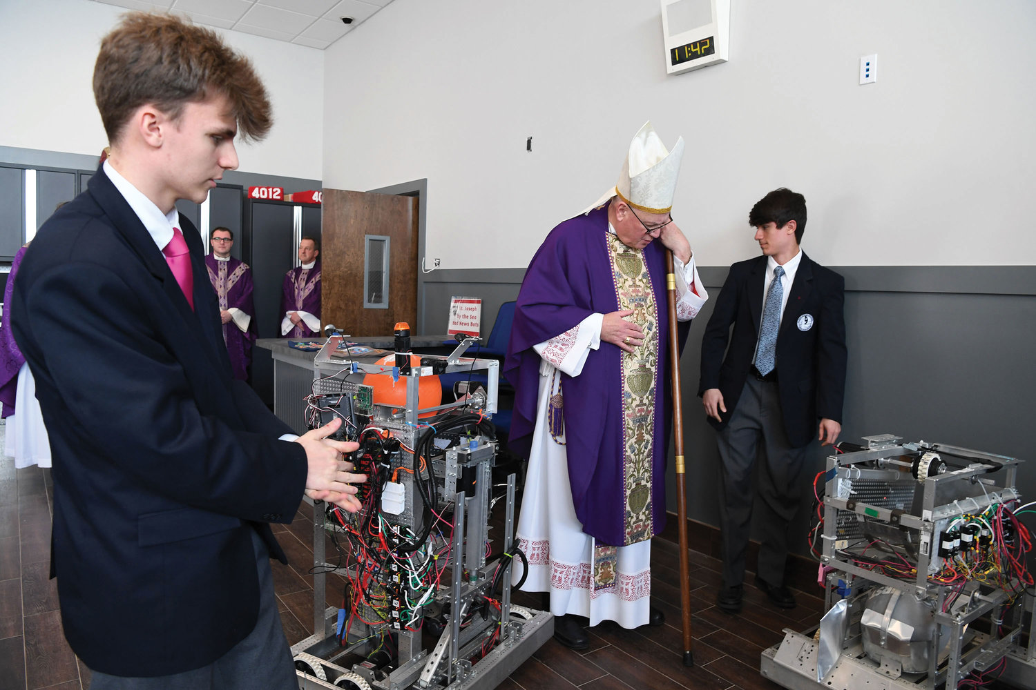 Cardinal Dolan takes a close look at robots in the new robotics classroom.