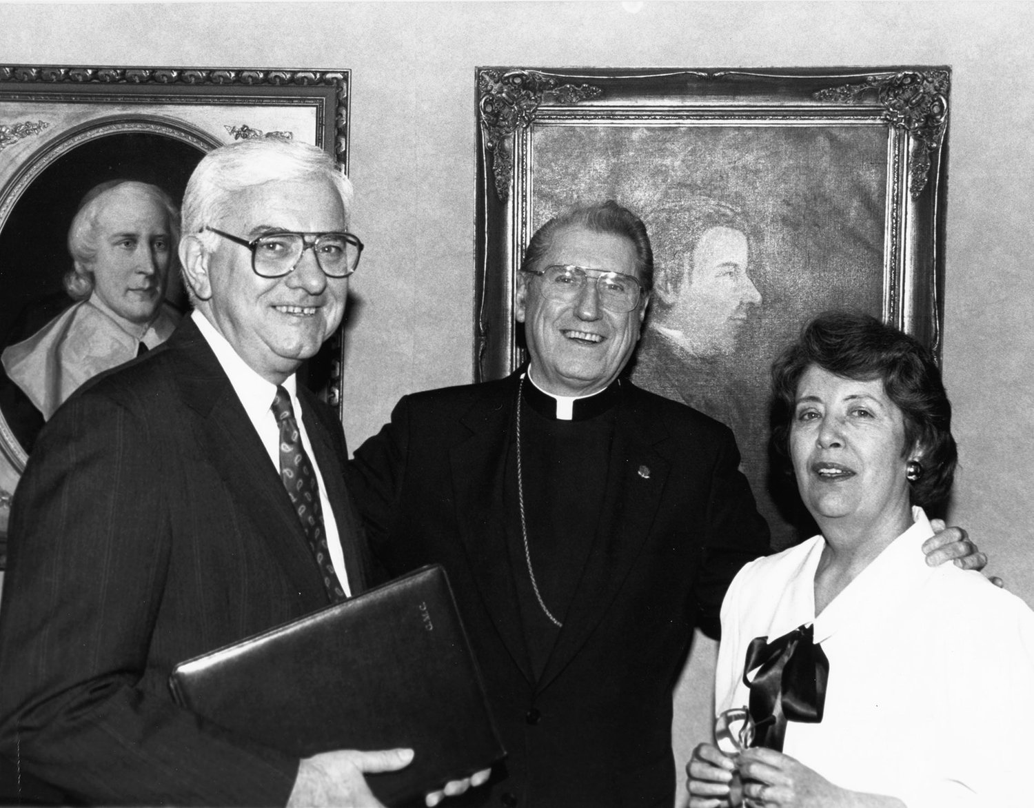 PROMOTION—In May 1990, Cardinal John O'Connor met with Gerald M. Costello, Catholic New York's founding editor in chief, and Anne M. Buckley, who the cardinal had named to succeed Costello the following year. Costello was retiring after serving as CNY's top editor for a decade.