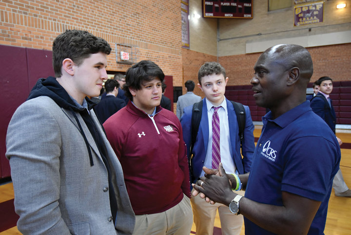 PERSONAL APPROACH—For the past 10 Lenten seasons, Thomas Awiapo has come to the United States to tell his story from both sides of the CRS Rice Bowl, as a recipient and as a CRS employee. Above, Awiapo speaks with Iona Prep students during his recent talk at the New Rochelle school.