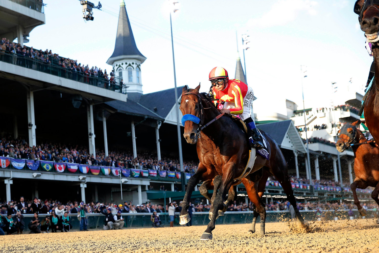 Jockey Mike Smith aboard McKinzie (6) runs down the front stretch during the 35th Breeders Cup world championships at Churchill Downs in Louisville, Ky., Nov 3, 2018. Smith, a Catholic, who will race in the Kentucky Derby May 4, prays before every race, but he doesn't pray to win.