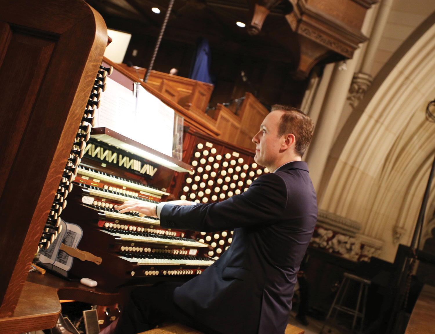 French musician Daniel Brondel, associate director of music and organist at St. Patrick's Cathedral, performs at the Friday evening concert.