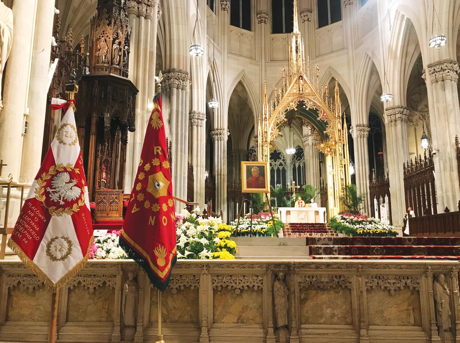 A portrait of St. John Paul II is displayed in the sanctuary of St. Patrick's Cathedral during the annual St. Pope John Paul II Tribute Mass Cardinal Dolan celebrated on Divine Mercy Sunday, April 28.