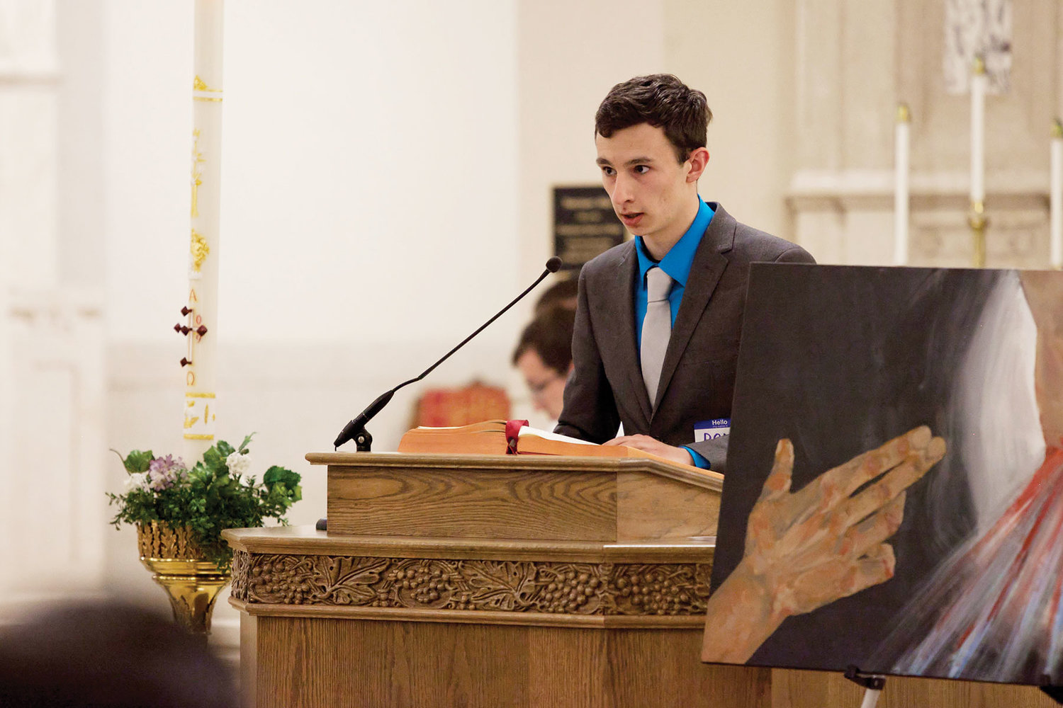 Dom Russo delivers the first reading during Mass in Most Holy Rosary Chapel at the Dominican Center.