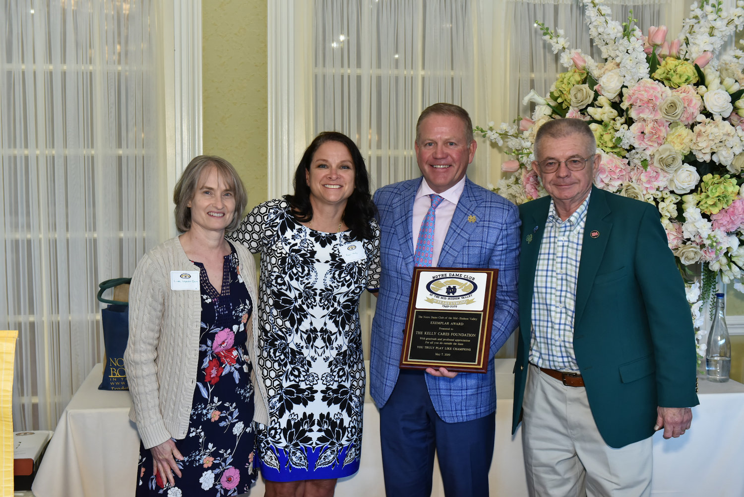 University of Notre Dame football coach Brian Kelly and his wife, Paqui, were presented with the Notre Dame Club of the Mid-Hudson Valley's Exemplar Award by club co-presidents Linda Legault Quinn, left, and Les McCarthy, right, at the 2019 Universal Notre Dame Celebration at the Grandview in Poughkeepsie May 7. The Kellys were recognized for their work with their Kelly Cares Foundation.