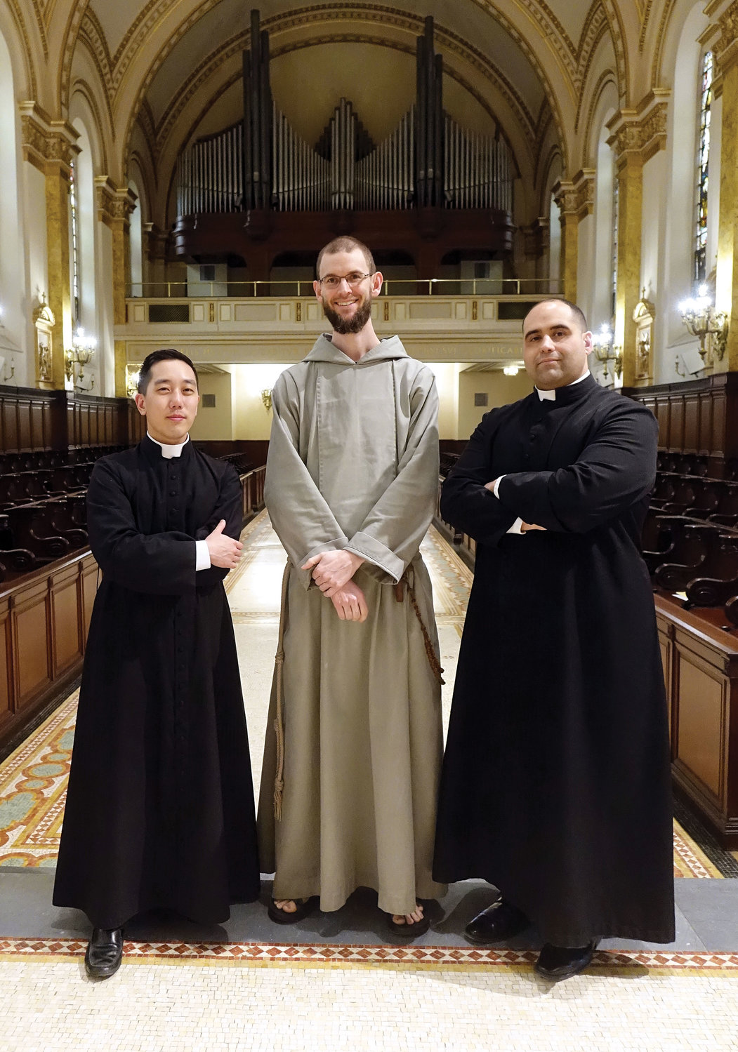 Three graduates of St. Joseph's Seminary, Dunwoodie, are among the six men Cardinal Dolan will ordain to the priesthood this Saturday, May 25, at St. Patrick's Cathedral. In the seminary chapel, from left are Father Roger Kwan, Father Gabriel Monahan, C.F.R., and Father John J. Figueroa.