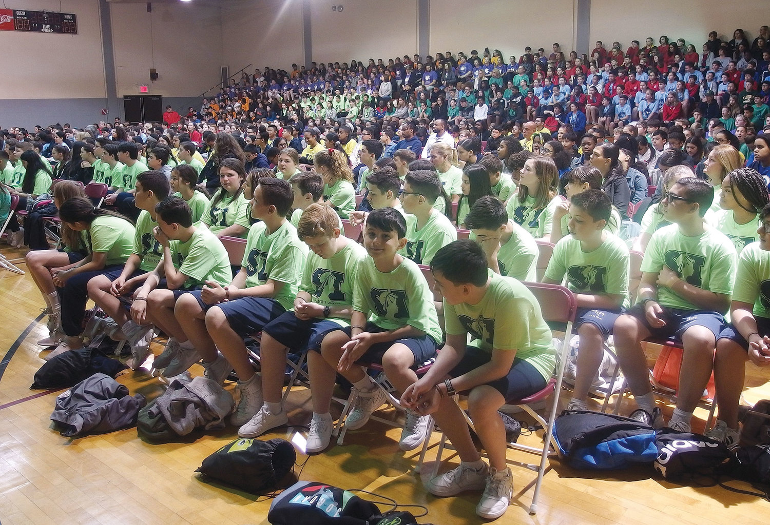 Nearly 1,000 students and faculty from 26 Catholic schools across the archdiocese gather for Mass in the gymnasium of St. Joseph's Seminary, Dunwoodie, May 8. Fun and games, from tug-of-war to three-legged races, followed outdoors on the seminary grounds at the annual archdiocesan Regional Field Day.