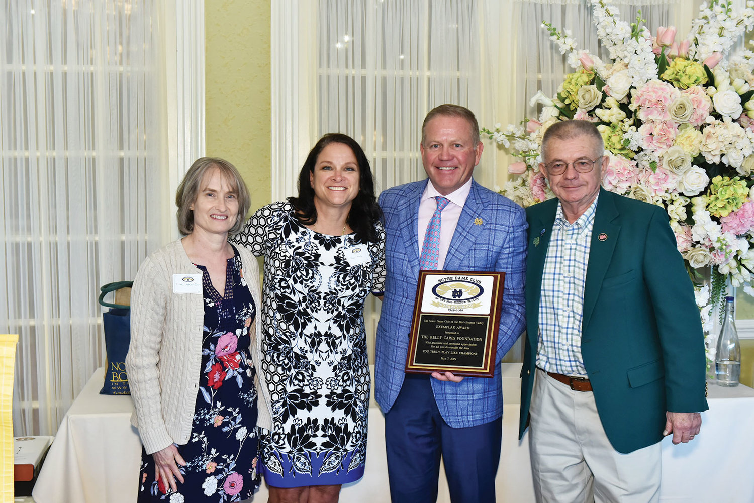 University of Notre Dame football coach Brian Kelly and his wife, Paqui, were presented with the Notre Dame Club of the Mid-Hudson Valley's Exemplar Award by club co-presidents Linda Legault Quinn, left, and Les McCarthy, right, at the 2019 Universal Notre Dame Celebration at the Grandview in Poughkeepsie May 7.