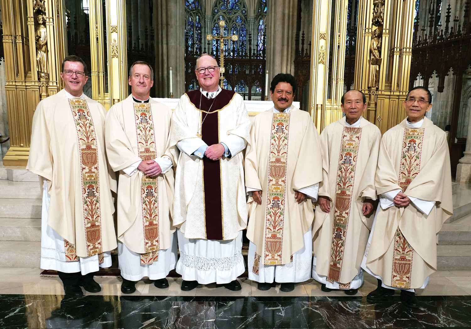 Joining Cardinal Dolan are, from left: Father Rees Doughty, Father Mark Vaillancourt, Father Segundo Benjamin Palacios, Father Ignatius Vu and Father Louis Van Thanh.