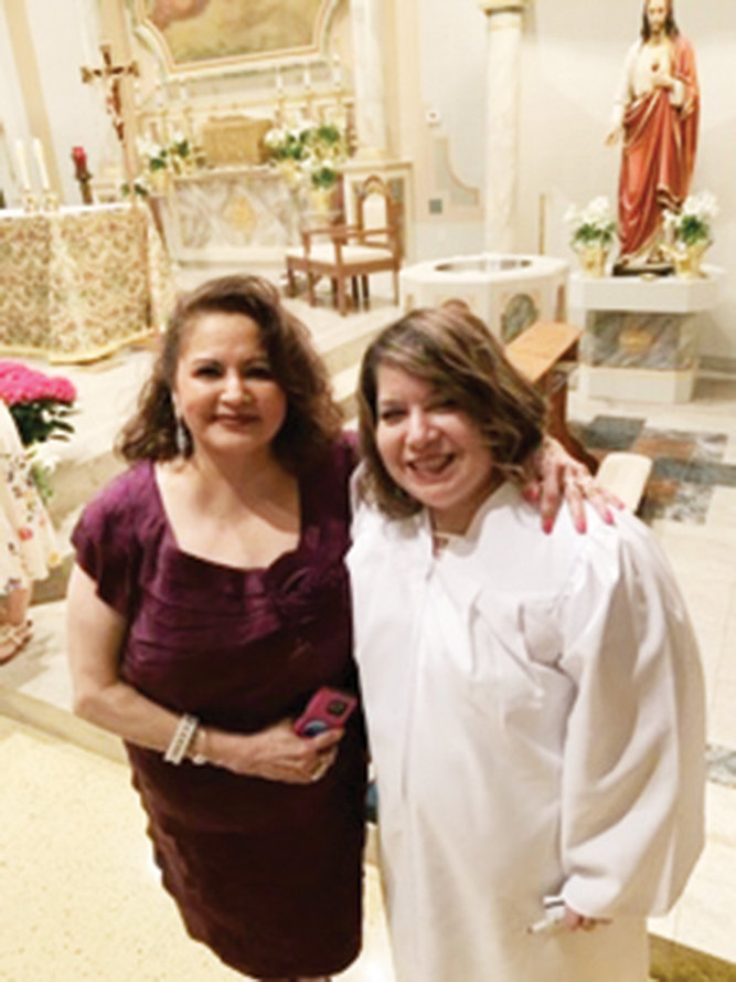 NEW CATHOLIC—Angela Valles, right, entered the Church at the Easter Vigil at her new parish, St. Joachim-St. John the Evangelist in Beacon. She is with her aunt, Gloria Garcia of Corpus Christi, Texas, who was her confirmation sponsor.
