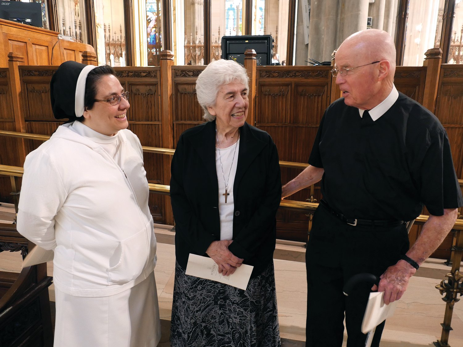 Sister Diane Mastroianni, A.S.C.J., Sister Deanna Sabetta, C.N.D. and Brother Joseph Reilly, F.S.C., who delivered the readings and prayer petitions at the 10:15 a.m. liturgy, converse after Mass.