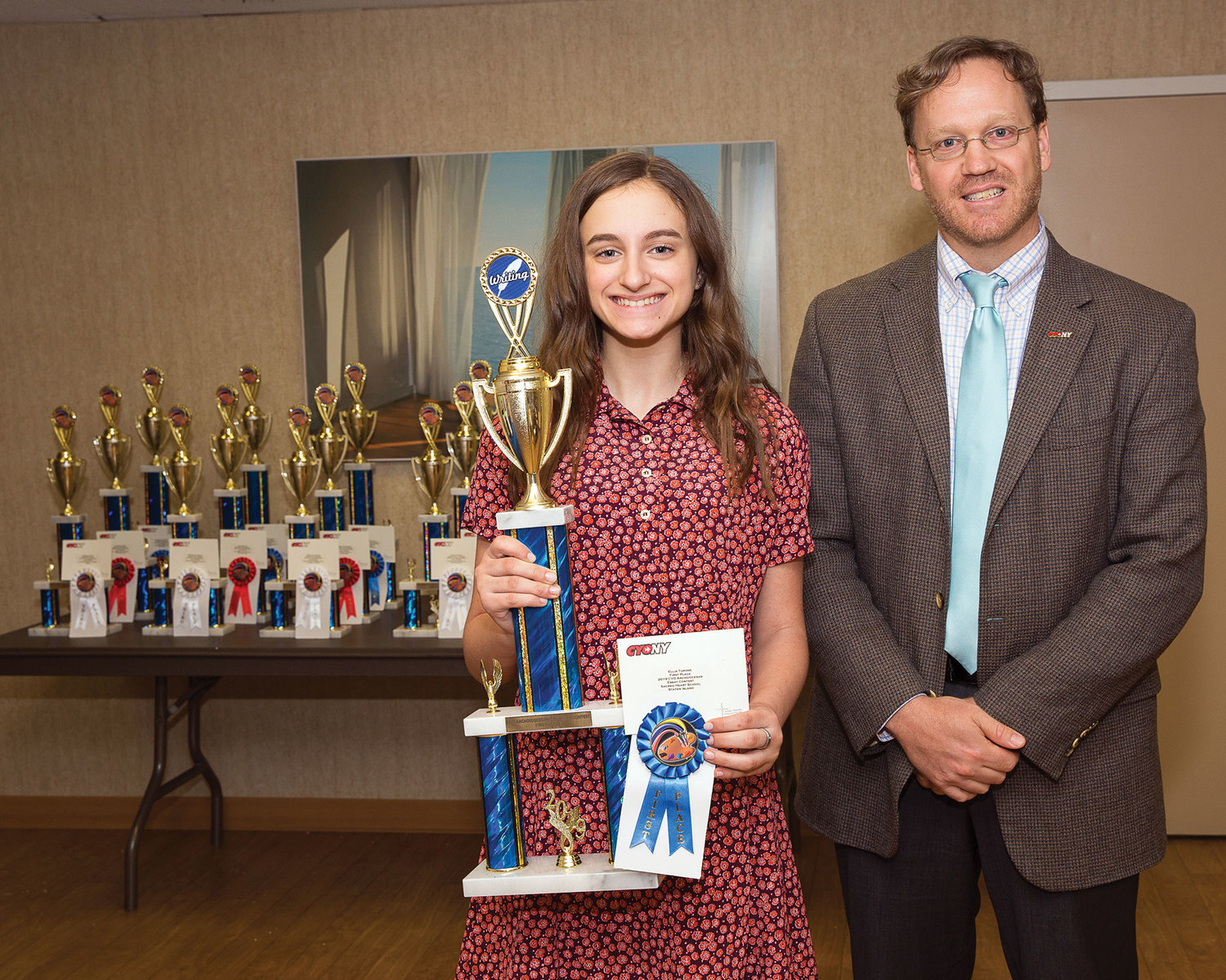 Ellia Tupone, a seventh-grader at Sacred Heart School on Staten Island, was the first-place essay winner in the archdiocesan CYO Art and Essay Contest. With her is Seth Peloso, CYO director.