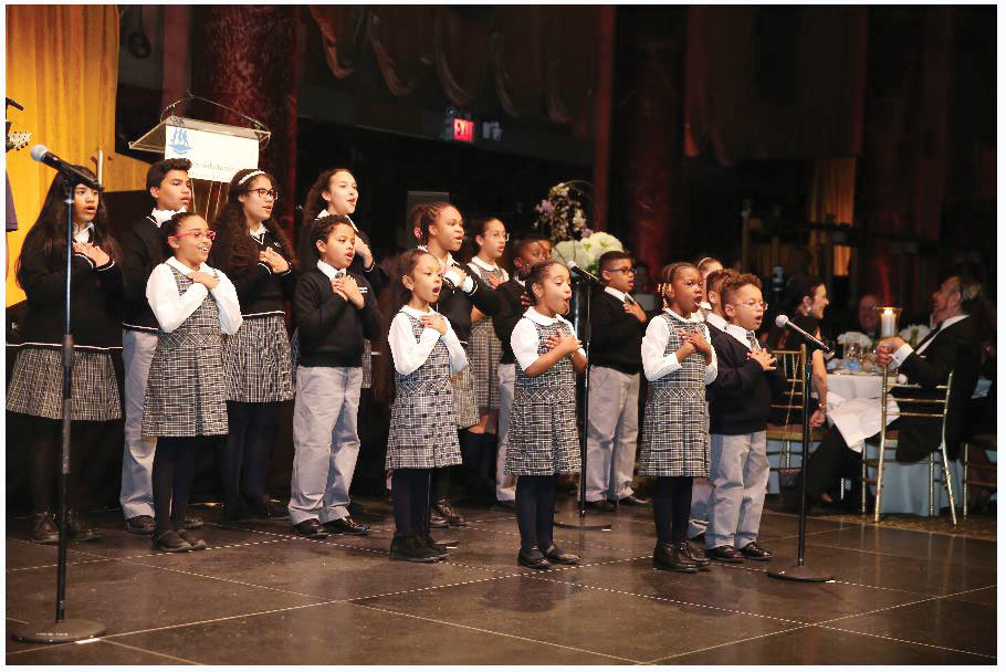 "St. Raymond Elementary School students perform the ""Sky is the Limit"" at the 43rd annual Inner-City Scholarship Fund Friends Gala at the Cipriani 42nd Street in Manhattan May 21."