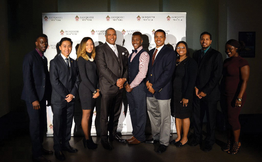 SECURING FUTURES—Robert F. Smith, founder, chairman and CEO of the private equity firm Vista Equity Partners, poses with Pierre Toussaint scholars at the Pierre Toussaint Awards Dinner in November 2015 in Harlem.