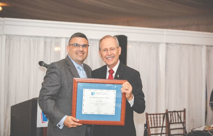 Joseph Daley, a radio personality from Q 92.1FM, accepts his certificate of appreciation from Carlos Perez, chairman of the Dutchess Catholic School Region, May 29 at the first Hope on the Hudson reception at The Grandview in Poughkeepsie