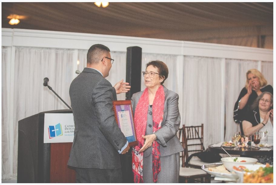 Mary Jane Daley, regional superintendent of schools for Dutchess and Northern Westchester/Putnam, accepts her certificate of appreciation from Carlos Perez, chairman of the Dutchess Catholic School Region, May 29 at the first Hope on the Hudson reception at The Grandview in Poughkeepsie.