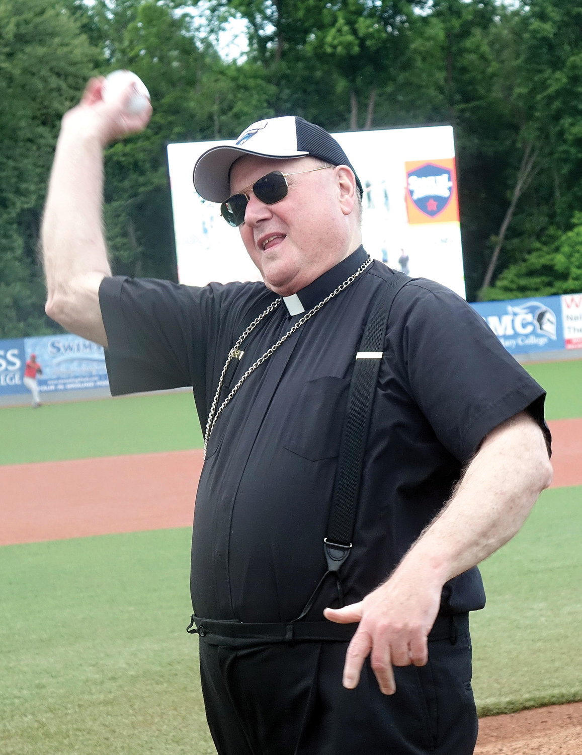 Cardinal Dolan throws out a ceremonial first pitch before the New York-Penn League game between the Hudson Valley Renegades and Lowell Spinners.