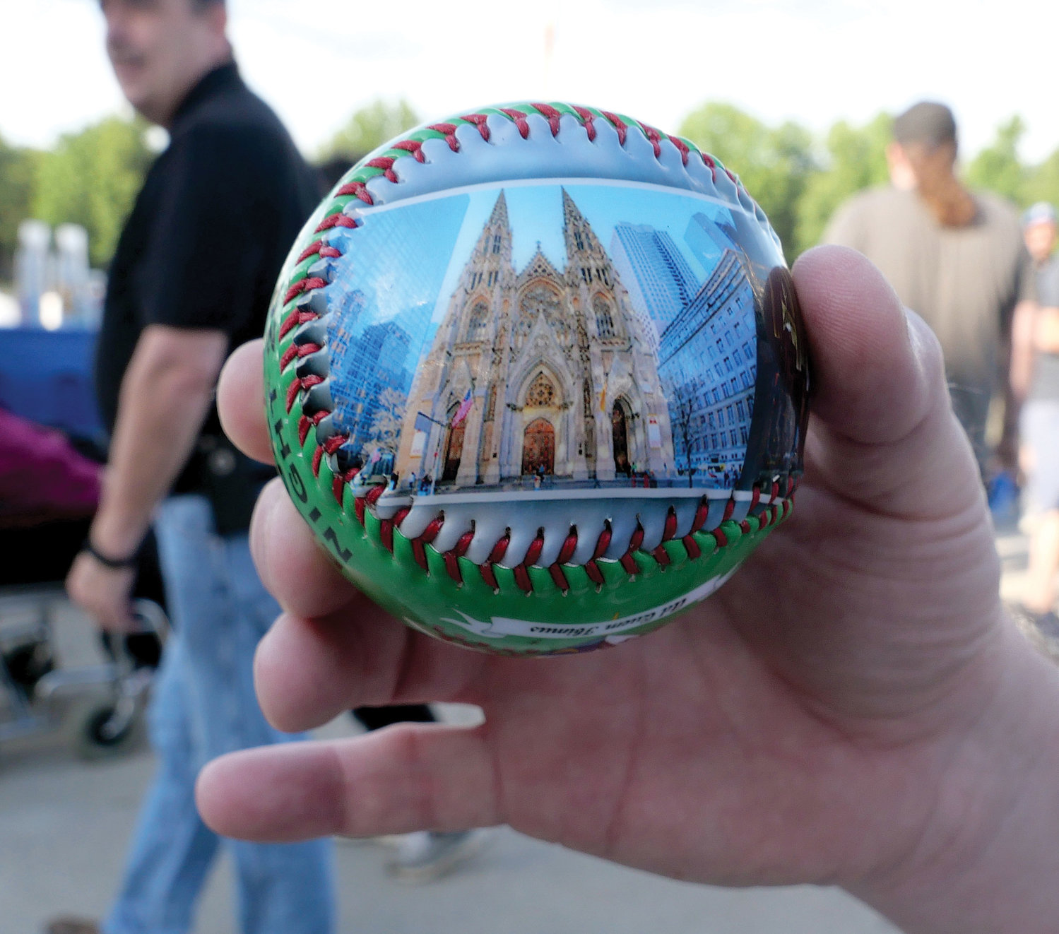 A commemorative baseball, which was given to fans, features an image of St. Patrick's Cathedral.
