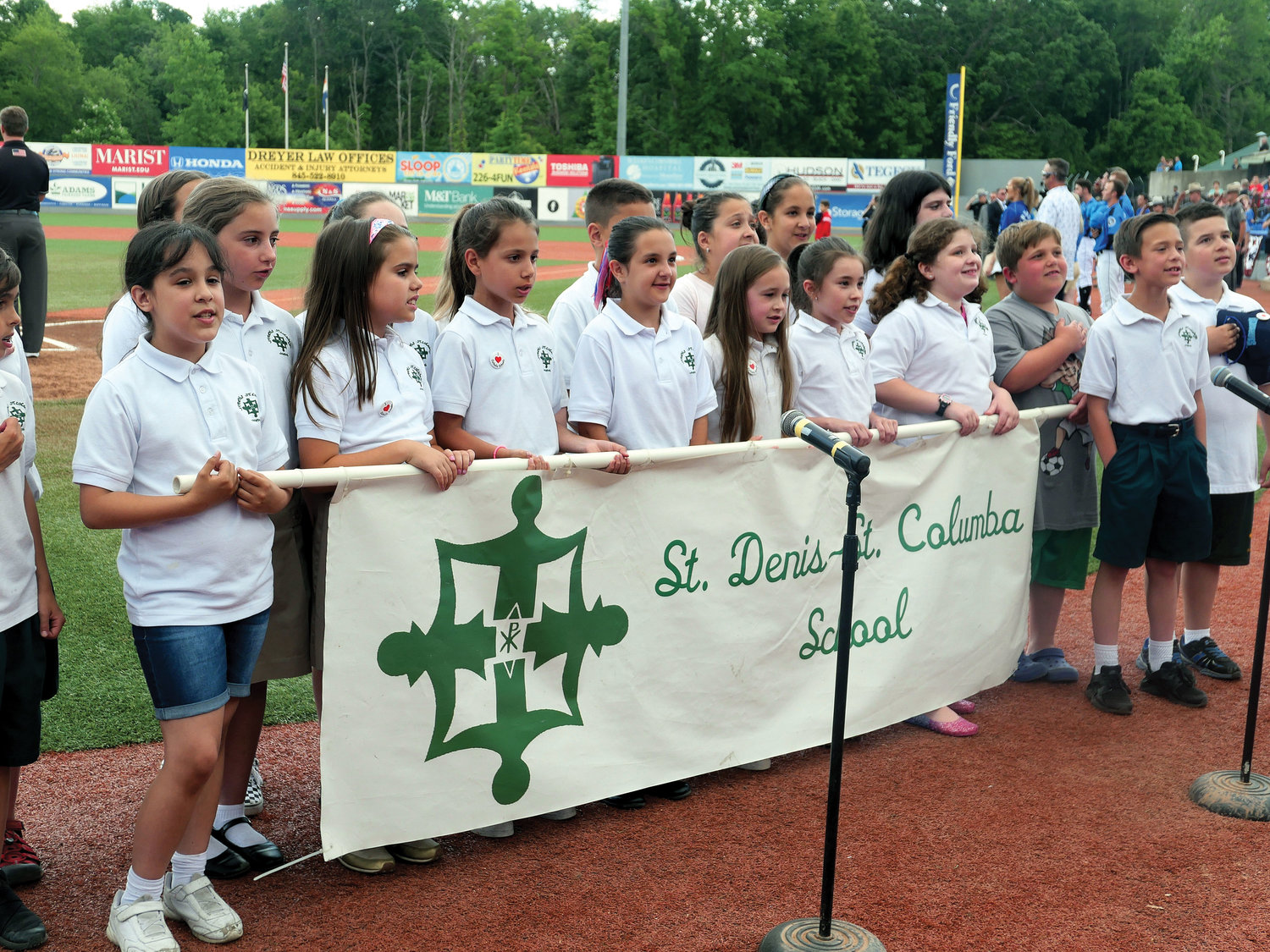 Students from St. Denis-St. Columba School in Hopewell Junction sing the National Anthem.