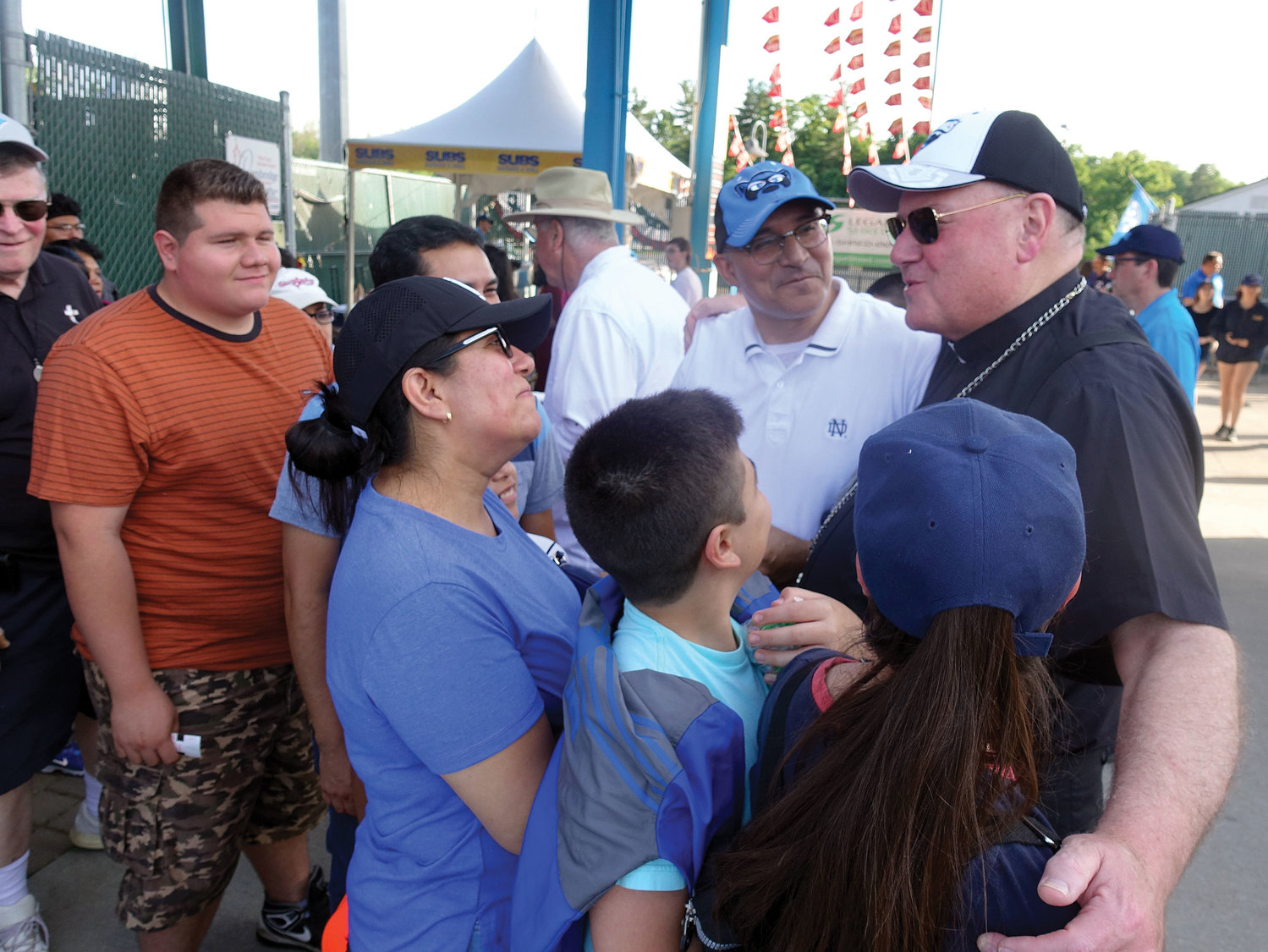 Cardinal Dolan greets fans during the ninth annual Catholic Education Night at Dutchess Stadium in Fishkill June 17.