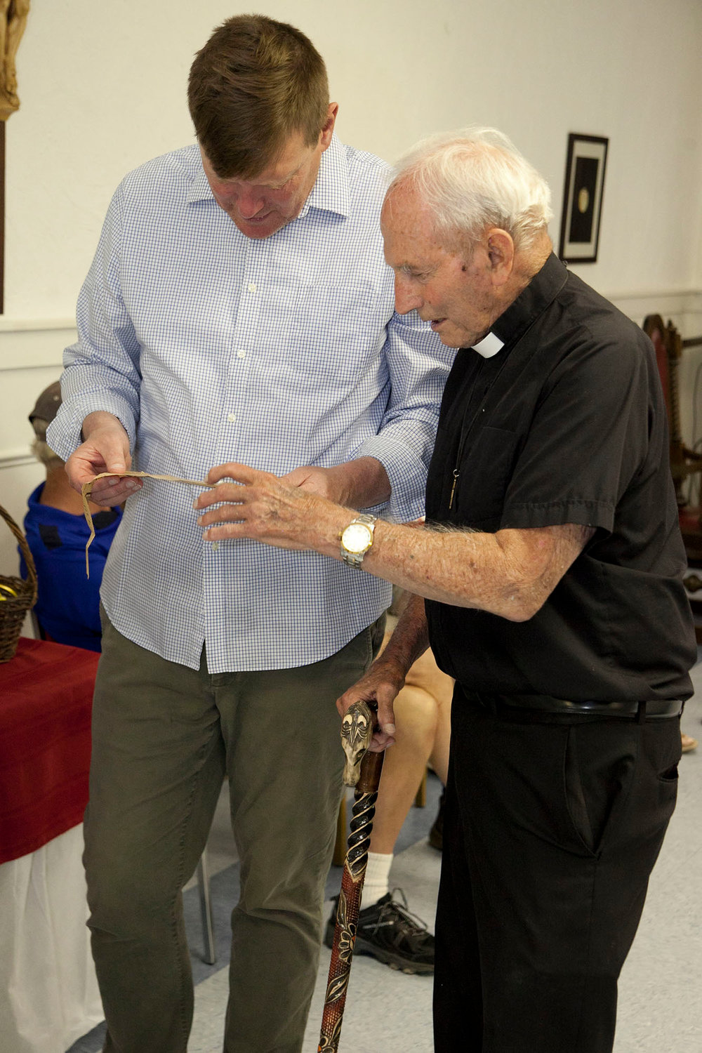 The 94-year-old priest will be retiring at the end of July. On June 9, Father Grohe greeted many old friends at an open house at Sacred Heart. Above, he and Matthew Loughlin peruse a newspaper clipping about his arrival in Esopus in 1969.