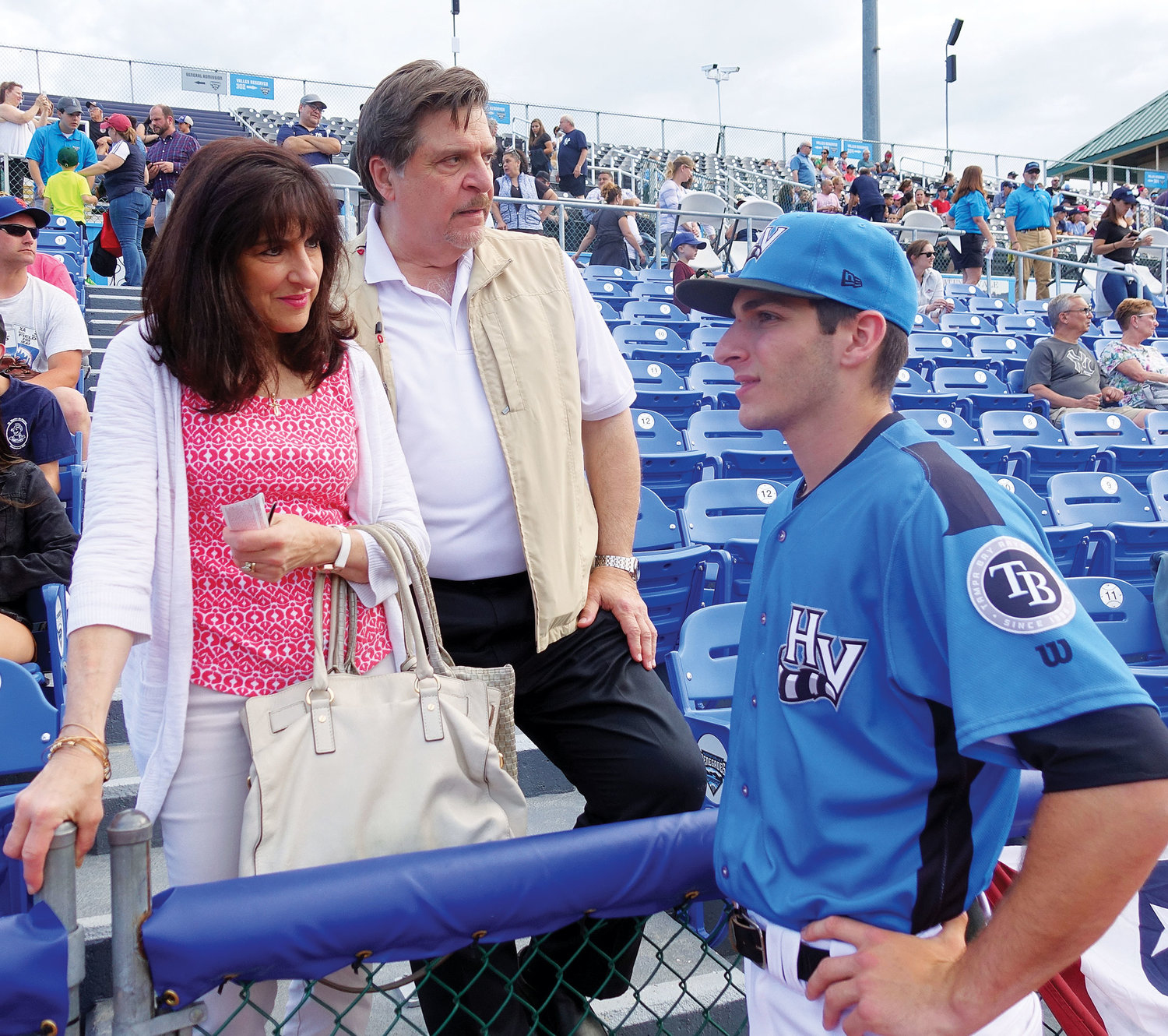 HOMECOMING—Joe LaSorsa, right, talks with his parents, Gregory and Diana LaSorsa, before his Hudson Valley Renegades met the Lowell Spinners in a New York-Penn League baseball game at Dutchess Stadium in Fishkill June 17. Joe LaSorsa was born and raised in Westchester County.