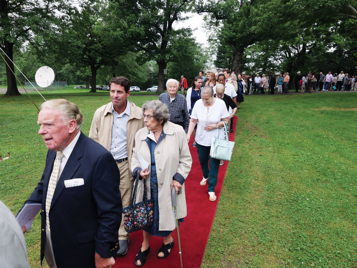 Patrons, volunteers and others associated with the archdiocesan capital campaign, Renew + Rebuild, take a walk on the red carpet to a white tent at St. Joseph Seminary in Dunwoodie for an outdoor reception June 20.