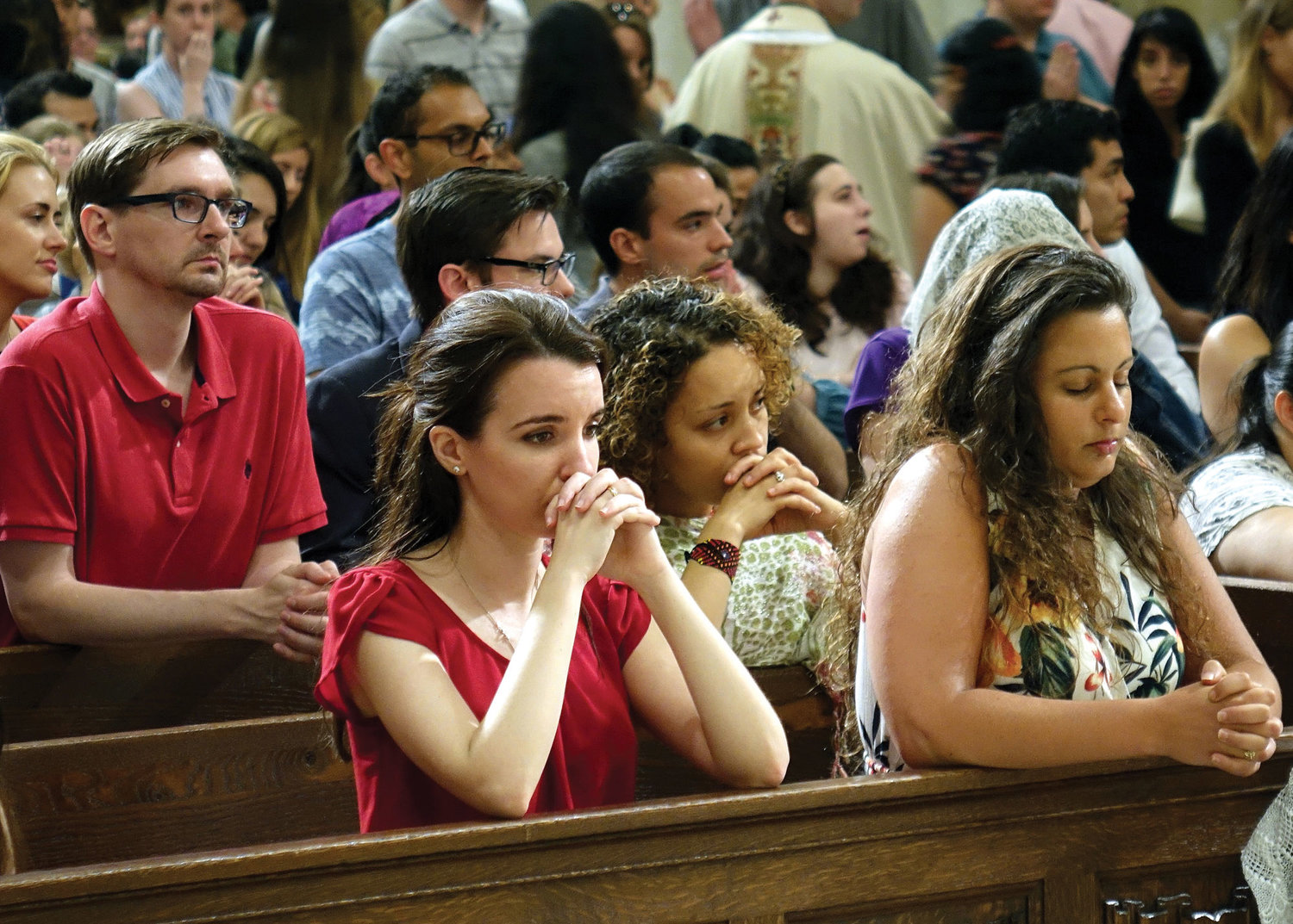Young adult Catholics pray at Mass celebrated for them by Cardinal Dolan at St. Patrick's Cathedral last July.