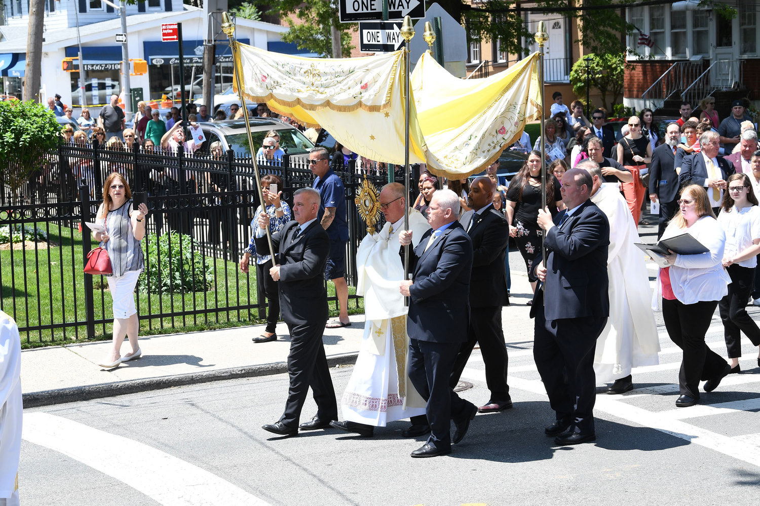 Cardinal Dolan carries the monstrance with the Eucharist in the procession after Mass.