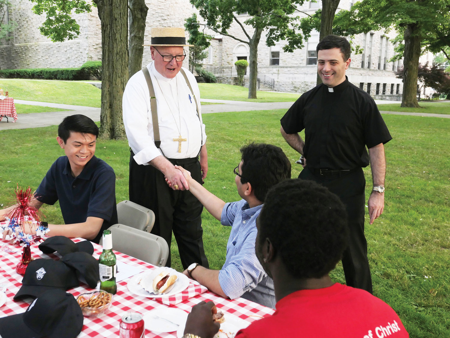 Cardinal Dolan and Father Christopher Argano, director of vocations for the archdiocese, meet New York seminarians, Cathedral Prep students and discerners at the fifth annual Summer Seminarian Gathering June 28 at St. Joseph's Seminary, Dunwoodie.
