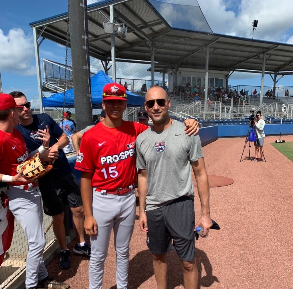 MEETING A LEGEND—Mount St. Michael Academy rising senior Alex Santos greets former New York Yankees captain Derek Jeter during the Prospect Development Pipeline League at IMG Academy in Bradenton, Fla. Jeter was an instructor and speaker at the camp sponsored by Major League Baseball and USA Baseball June 13-July 4.