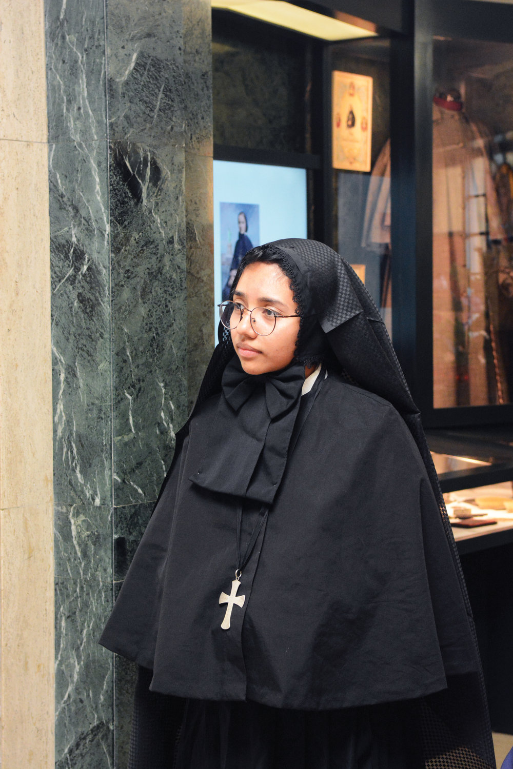 Bianca Huertas, dressed in period attire of Mother Cabrini's Missionary Sisters of the Sacred Heart of Jesus, was a perfect fit at a celebration marking the saint's 169th birthday July 13 at the Manhattan shrine named for her. Ms. Huertas, who was born in Guatemala, is in her first year of formation with the Cabrini Sisters.