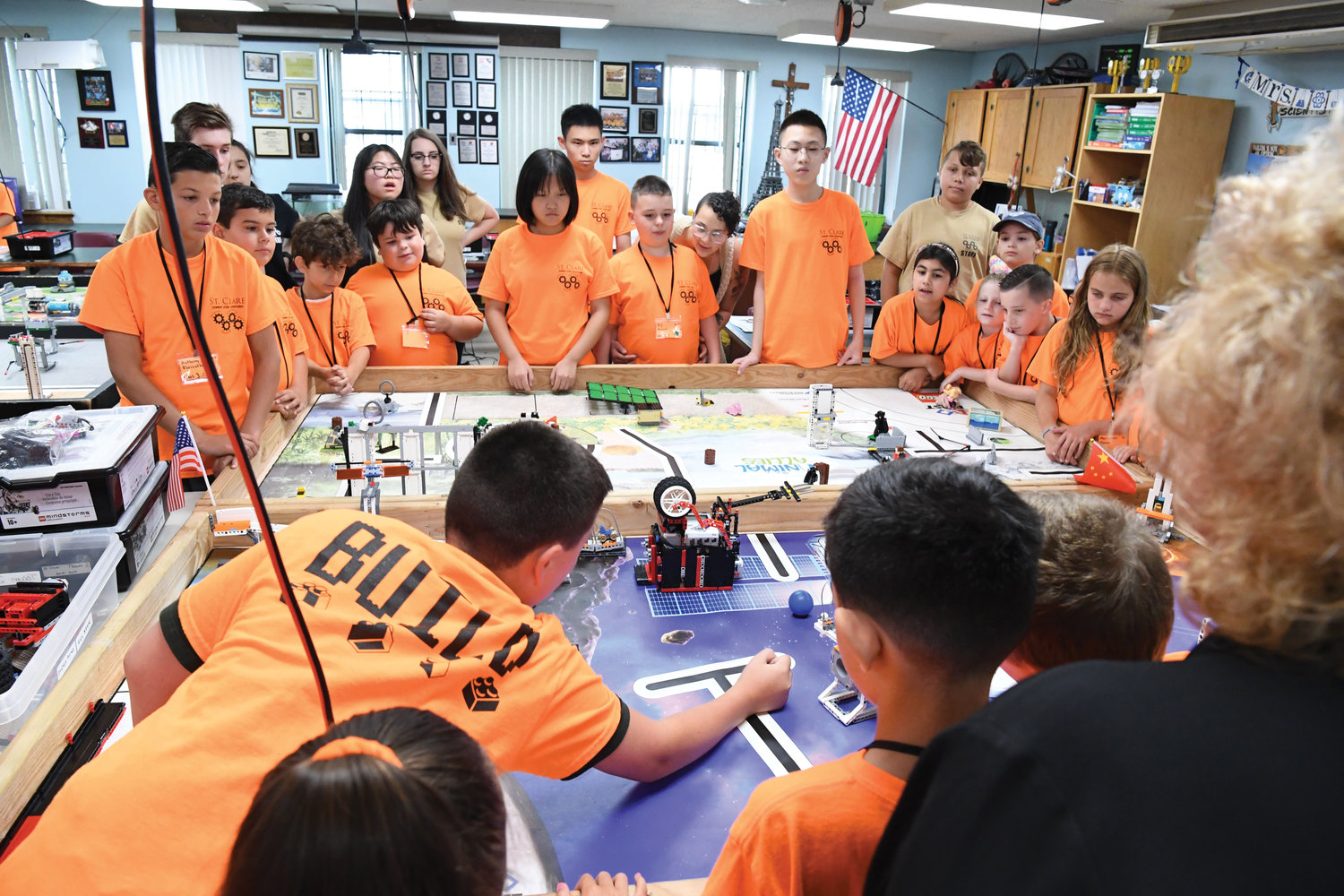 Youths watch fellow students July 10 during robot demonstrations at the Summer STEM and Robotics Adventure Program at St. Clare's School on Staten Island. The program included four cultural exchange students from China.