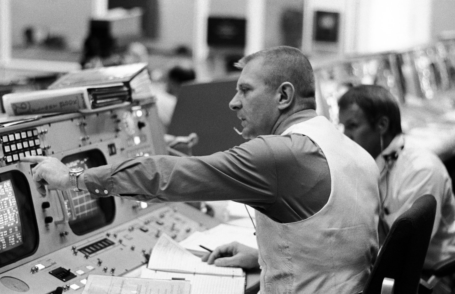 Flight director Gene Kranz is seen seated at his console in the mission operations control room in the Manned Spacecraft Center's Mission Control Center in Houston the launch of the Apollo 11 lunar landing mission July 16, 1969. Partially visible in the background is flight director Gerald D. Griffin. Kranz is a parishioner at Shrine of the True Cross Catholic Church in Dickinson, Texas, near Houston.