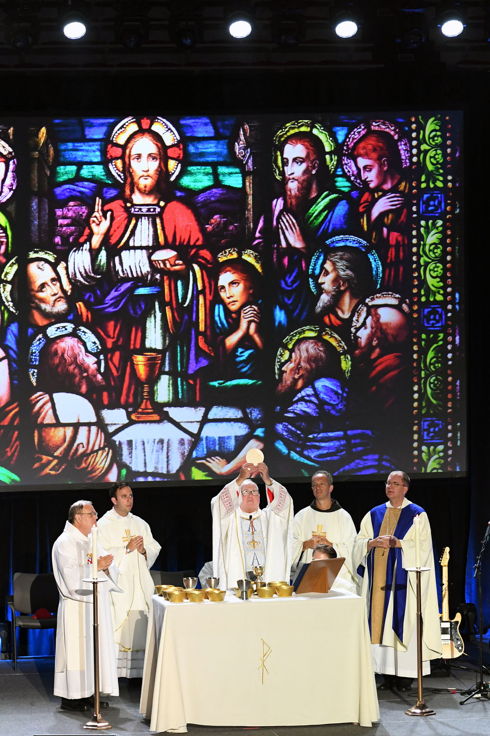 Cardinal Dolan elevates the Eucharist during the Mass he offered July 20 at Steubenville NYC at St. John's University in Queens.