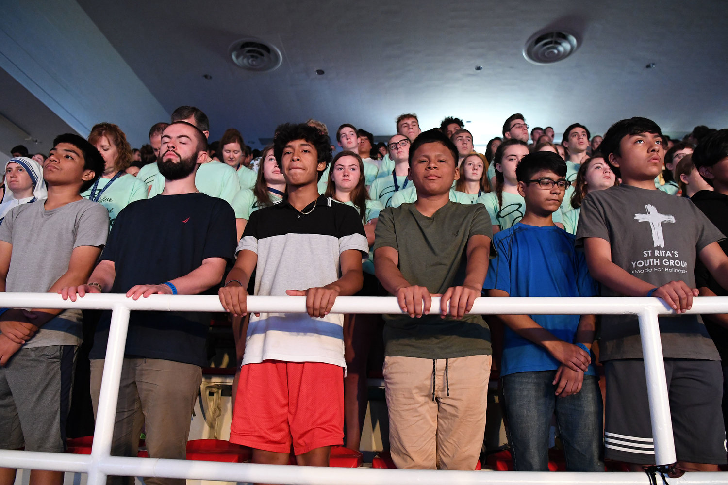 Teens from St. Rita of Cascia and St. Pius V parish in the Bronx attend the Mass Cardinal Dolan celebrated July 20 at Steubenville NYC at Carnesecca Arena on the campus of St. John's University in Queens.