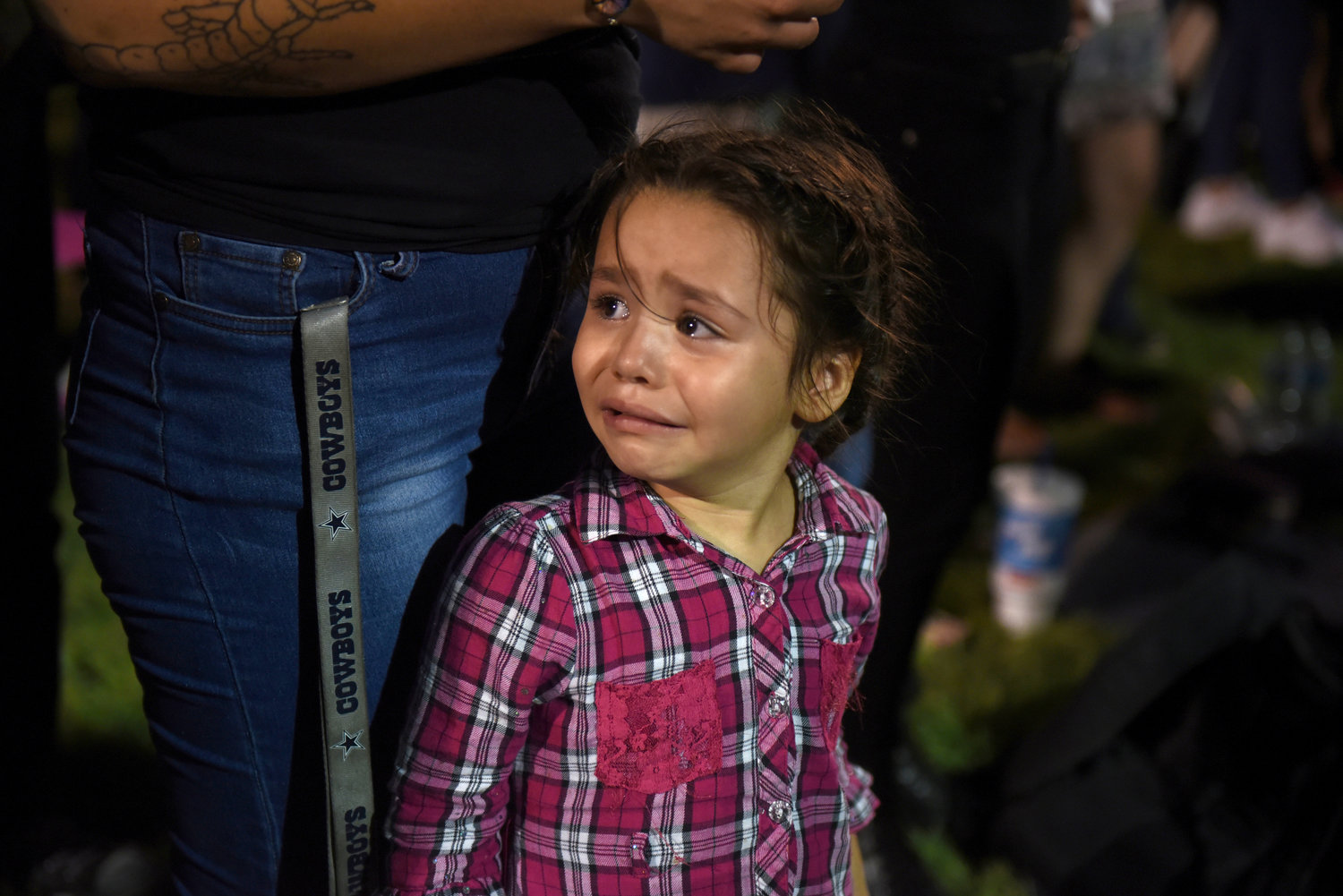 Serenity Lara cries during an Aug. 4 vigil, a day after a mass shooting at a Walmart store in El Paso, Texas.