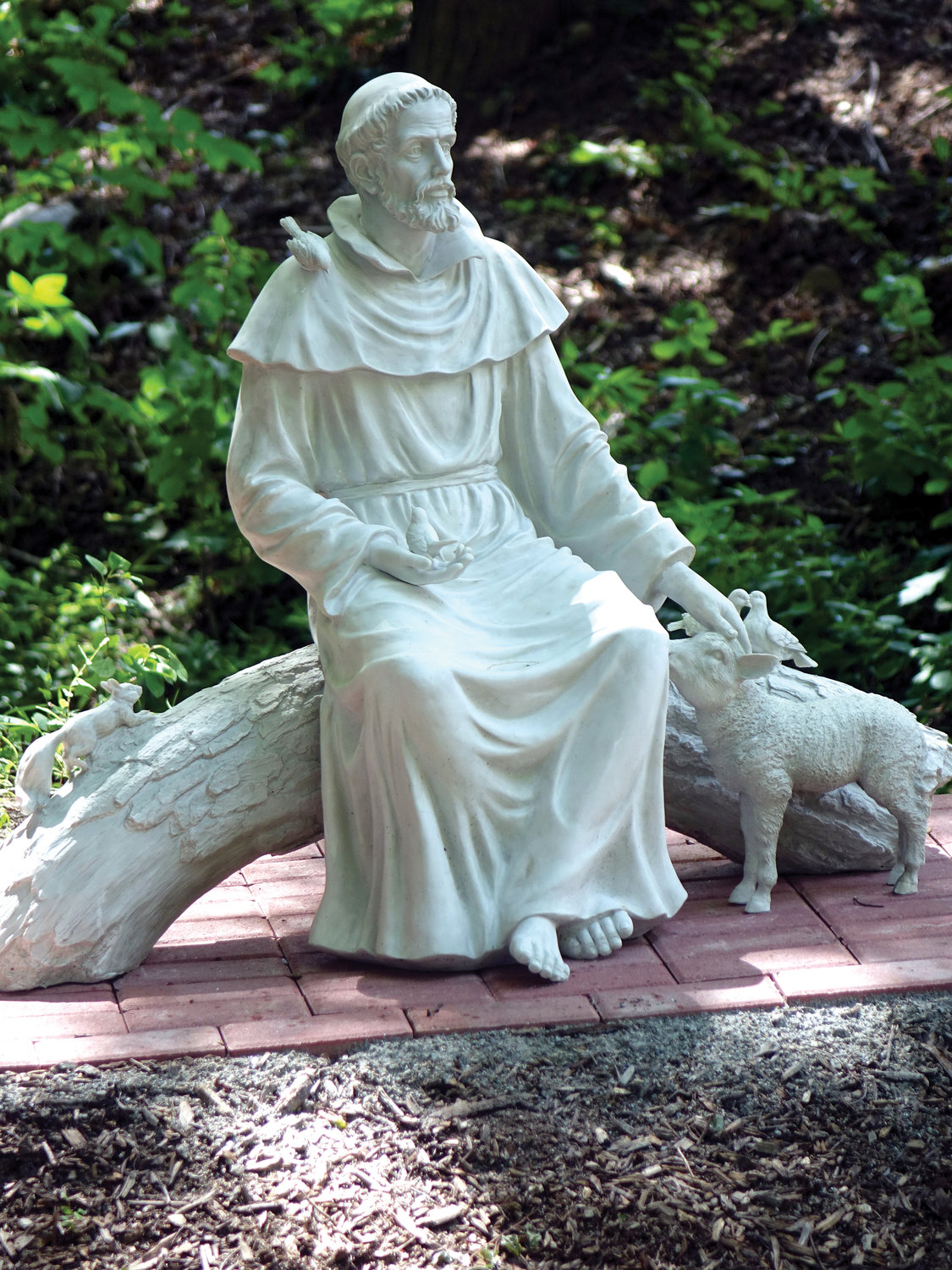 A statue of St. Francis is part of the St. Francis Prayer Garden.