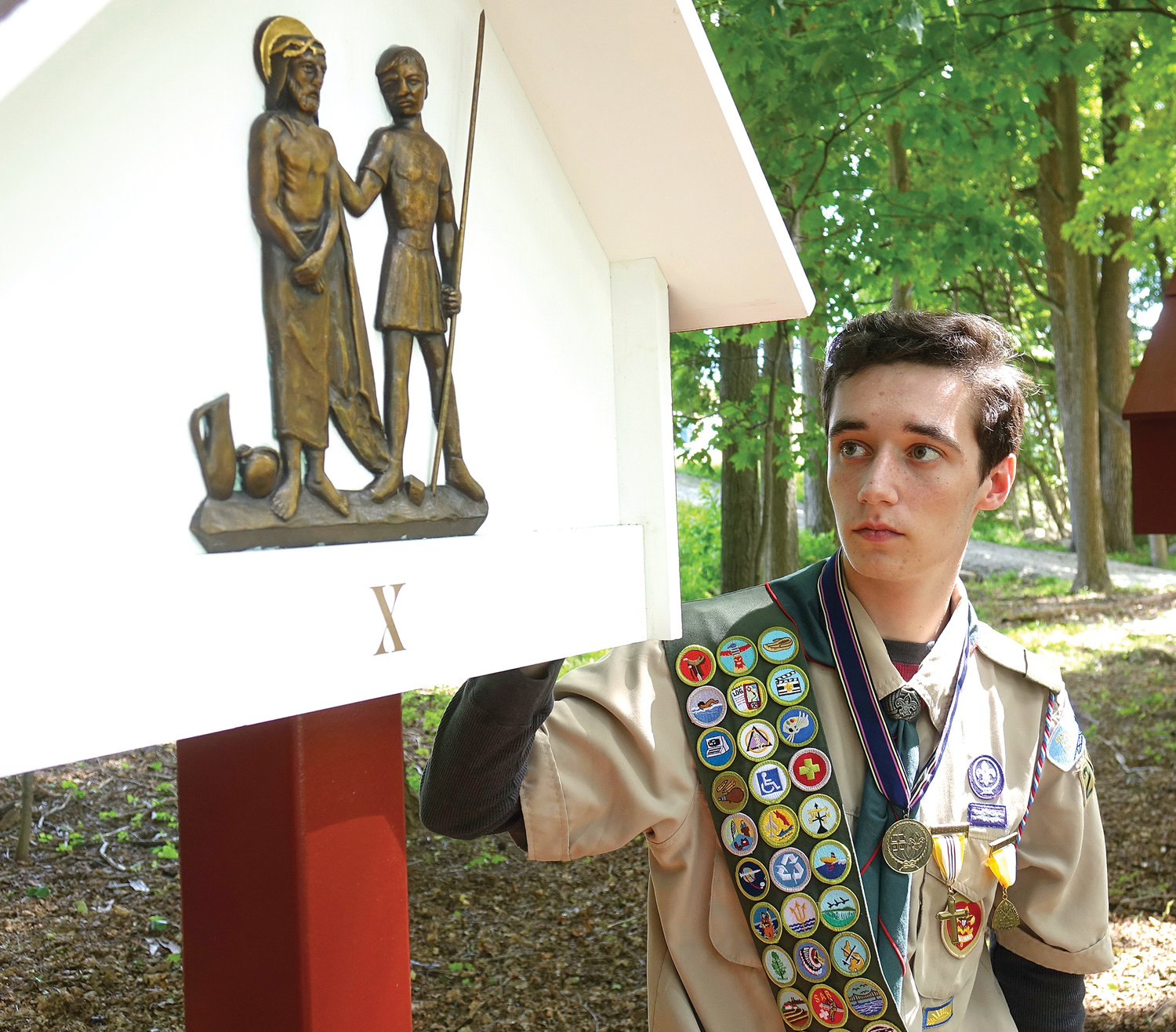 Scout Philip Dever repurposed the Stations of the Cross plaques from the convent chapel to create an outdoor Way of the Cross for his Eagle Scout project.